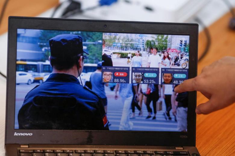 A promotion video shows an actor wearing LLVision facial recognition smart glasses during a demonstration at the company's office in Beijing