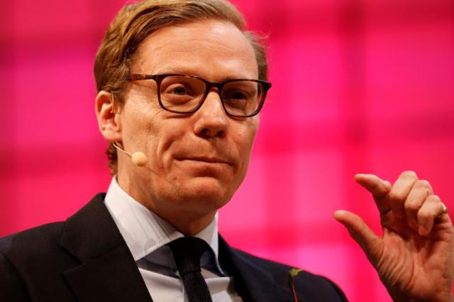 CEO of Cambridge Analytica, Alexander Nix, gestures during the Web Summit, Europe's biggest tech conference, in Lisbon