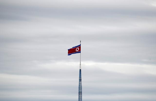 A North Korean flag flutters on top of a 160-metre tower in North Korea's propaganda village of Gijungdong, in this picture taken from the Tae Sung freedom village near the Military Demarcation Line (MDL), in Paju