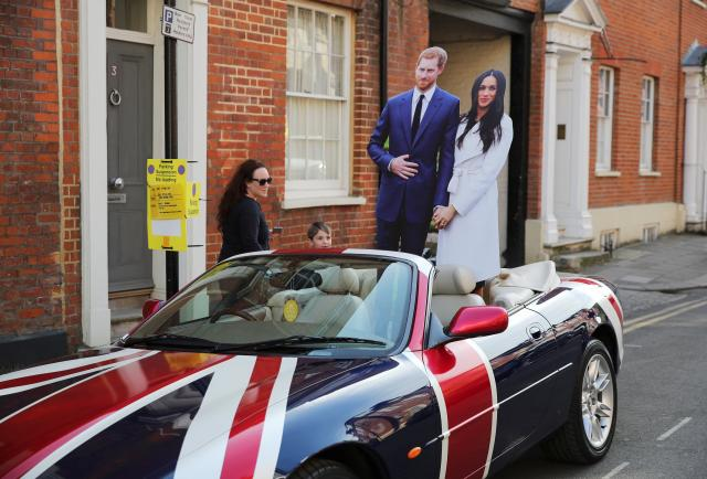 A Jaguar convertible with a Union Flag paint scheme and lifesize cardboard cut outs of Britain's Prince Harry and his fiancee Meghan Markle is parked in Windsor a day before their wedding at Windsor Castle