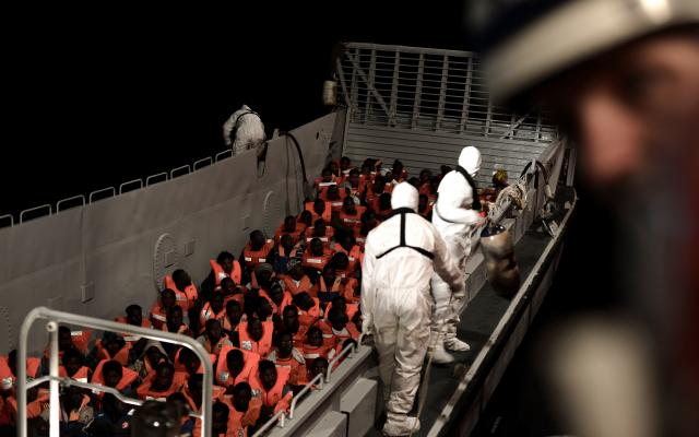 Migrants are rescued by staff members of the MV Aquarius, a search and rescue ship in the central Mediterranean Sea