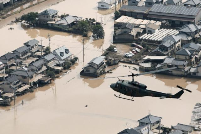 A helicopter flies over Mabi town which was flooded by the heavy rain in Kurashiki