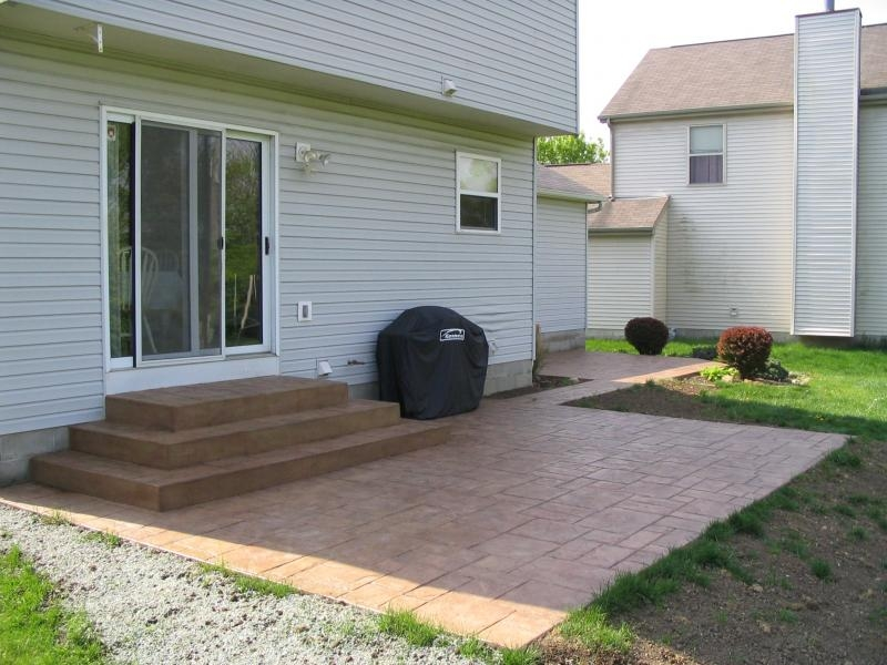 Atlantis Concrete And Construction Llc Photo Gallery | Patio With Stairs From House | Residential | Curved Paver | Main Entrance Stamped Concrete Front | Walkout Basement | Decorative