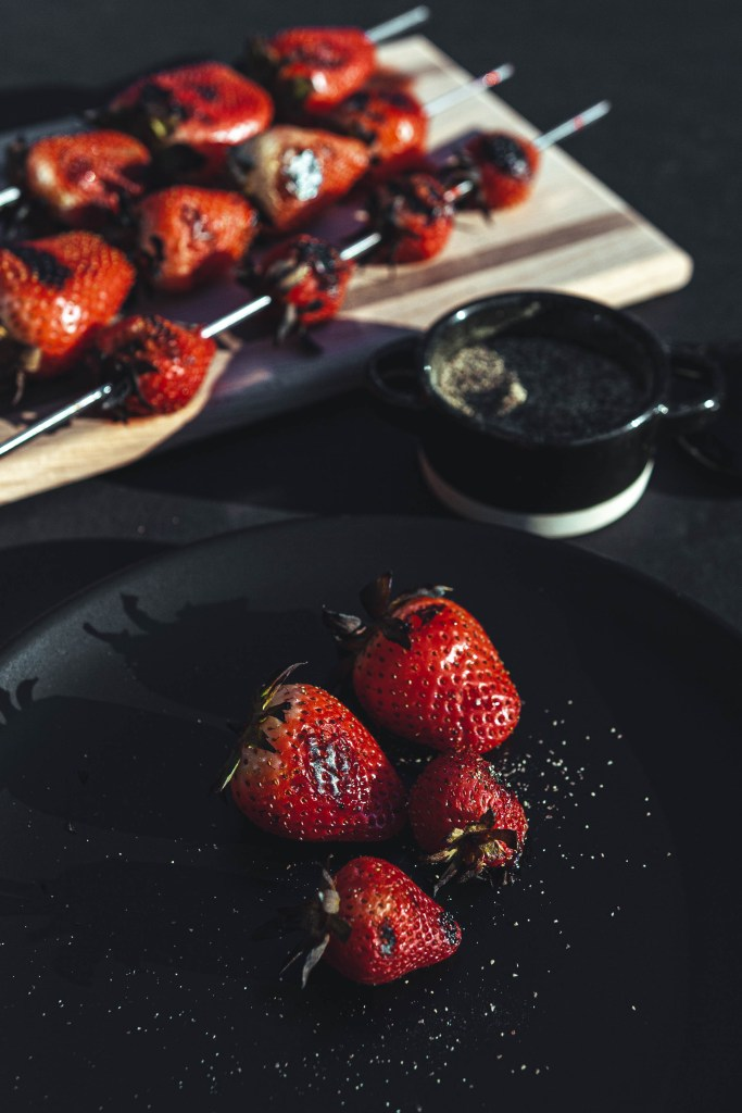 photo of grilled strawberries with black pepper