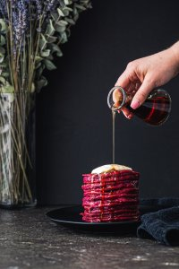 Hot pink beet pancakes with a drizzle of syrup
