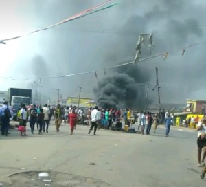 Okada and Keke ban: Iyana ipaja under intense protest as LASMA car gets set ablaze