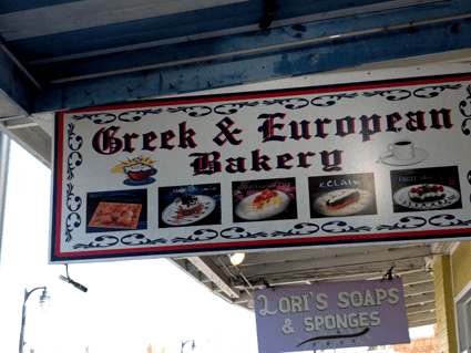 at mimis table tarpon springs greek and european bakery sign