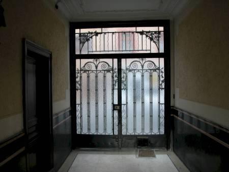 heavy metal door with glass latch
