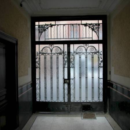 heavy metal door with glass latch