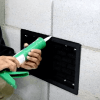 Photo caulking the ATMOX Grilled Solid Vent Plate after installation