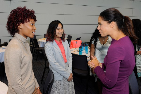 Soledad Obrien speaking with students Monica Fitzpatrick (Left) and Amy Kato both of John Carroll University. © Eric Espada/Starfish Foundation