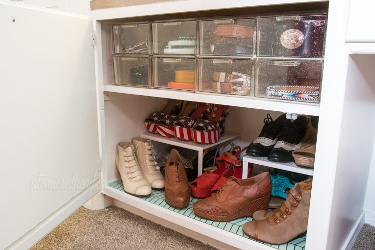 Inside cabinet, including shoes, and clear storage for belts