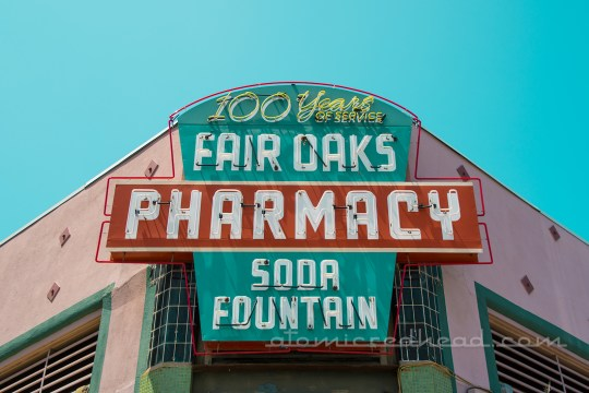 Fair Oaks Pharmacy neon sign, done in green, red, and white.
