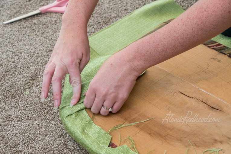 Make careful folds to curve the fabric around.