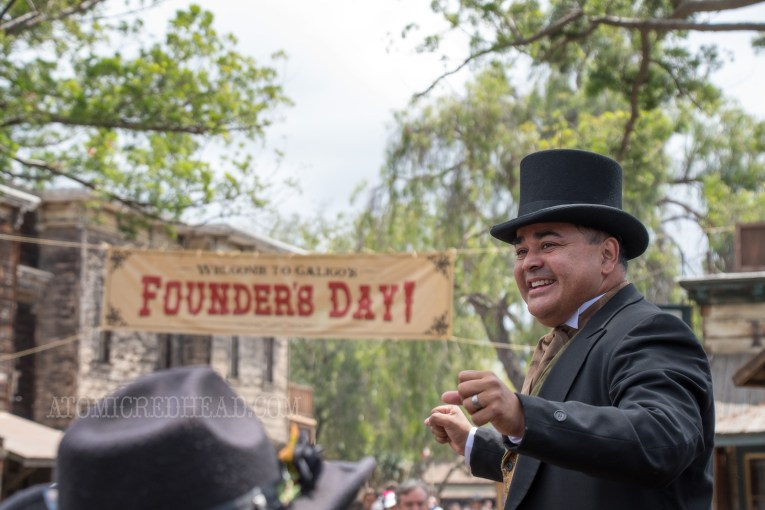 The town mayor, Horton Parnell, with the banner for Founder's Day in the background.