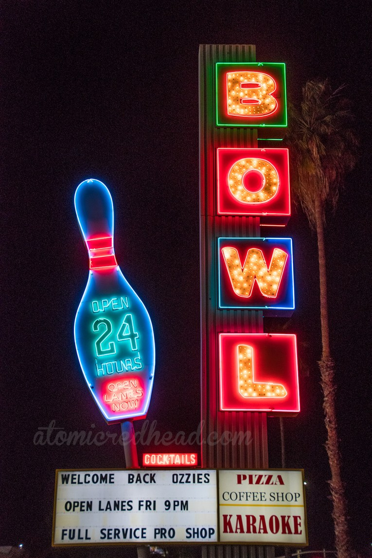 "Linbrook Bowl's sign, with a massive bowling pin on the right, reading ""Open 24 hours"" and Bowl spelled out down on the right."