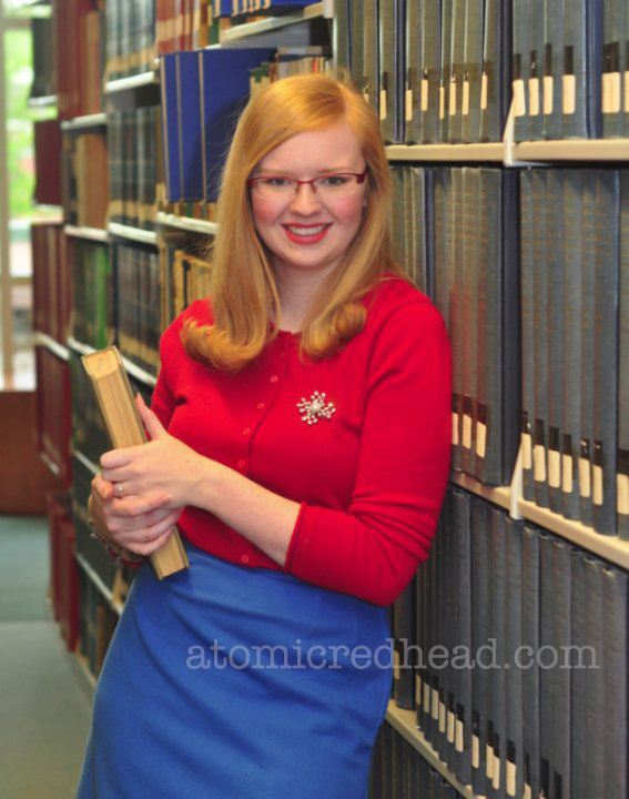 My college graduation photo - a red sweater from Target and a vintage blue pencil skirt and a vintage rhinestone brooch.