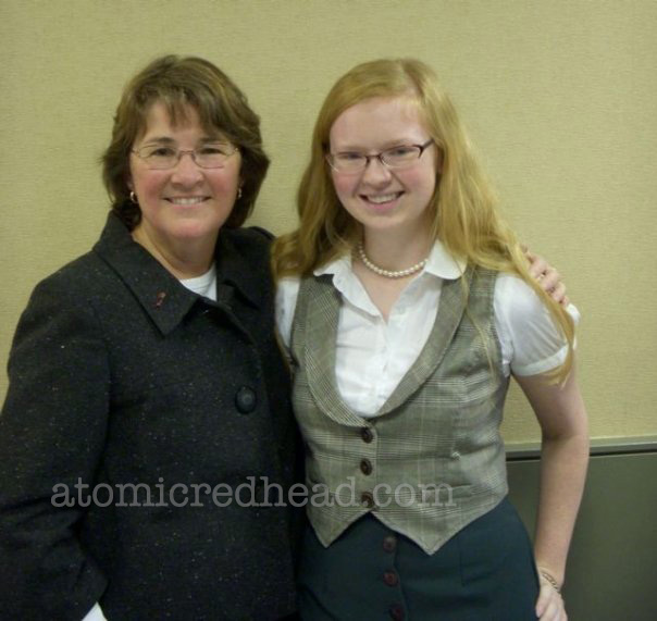 Me with Jan Eliot. 2007 I want to say... Wearing a white blouse with a plaid vest, and dark green skirt, and a strand of pearls.