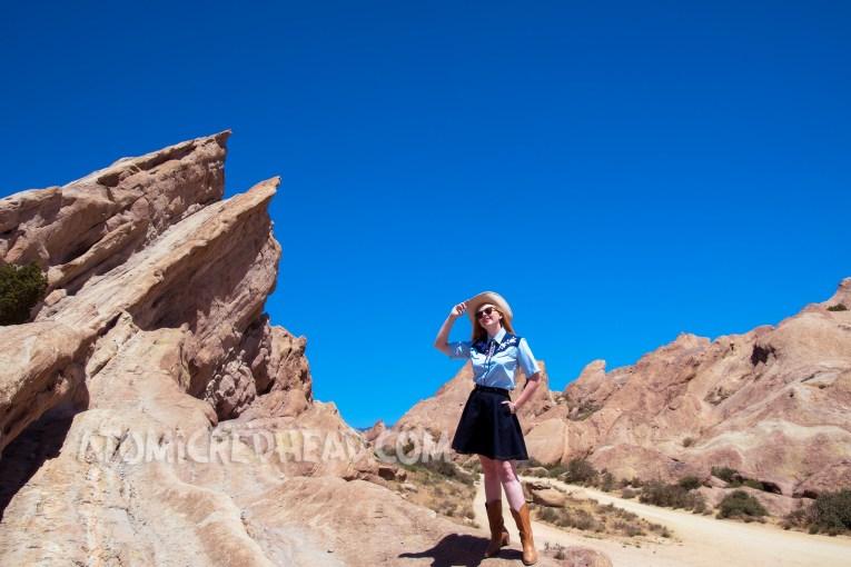 Atop Vasquez Rocks in a denim skirt, two-tone western shirt, UFO bolo tie by Kesha, and a cream western wear hat.