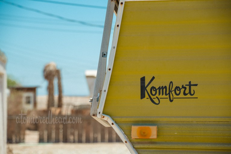 """Vintage camper by """"Komfort"""" two-tone, white and olive green."""