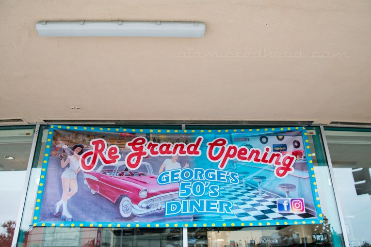 "Banner reading ""Re-Grand Opening George's 50s Diner"""