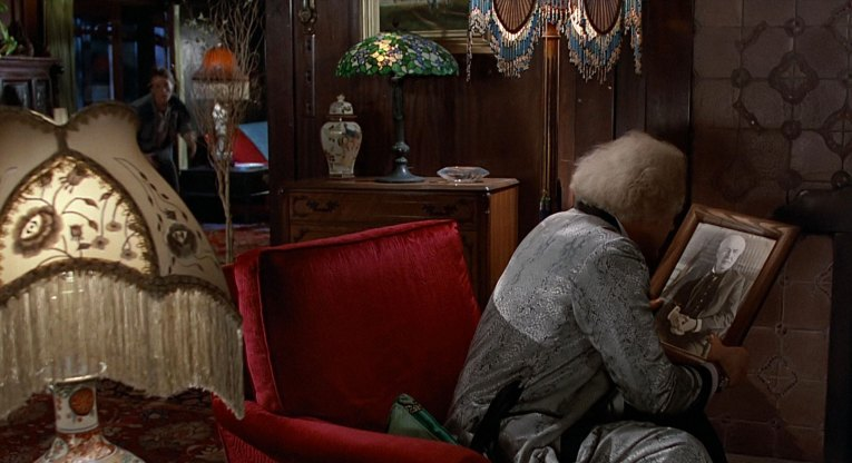Interior of the Blacker House as seen in Back to the Future - Doc sits by his fireplace contemplating the problem of how to send Marty back to the future. Similar dark wood and Japanese influences.