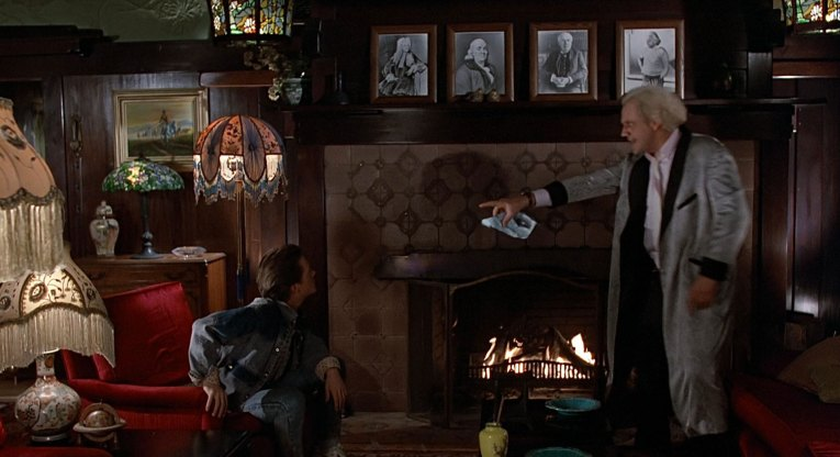 Interior of the Blacker House as seen in Back to the Future - Doc and Marty discuss how to get Marty back to 1985. Craftsman tile fireplace and dark wood walls.