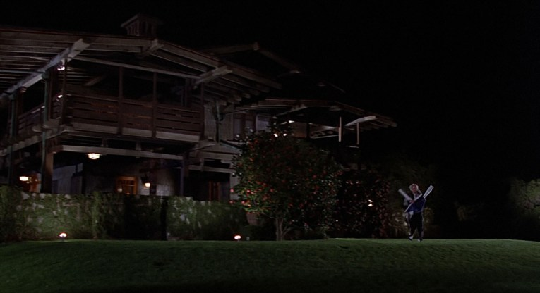 Screencap from Back to the Future - Doc Brown tries to escape Marty by running out from the house.