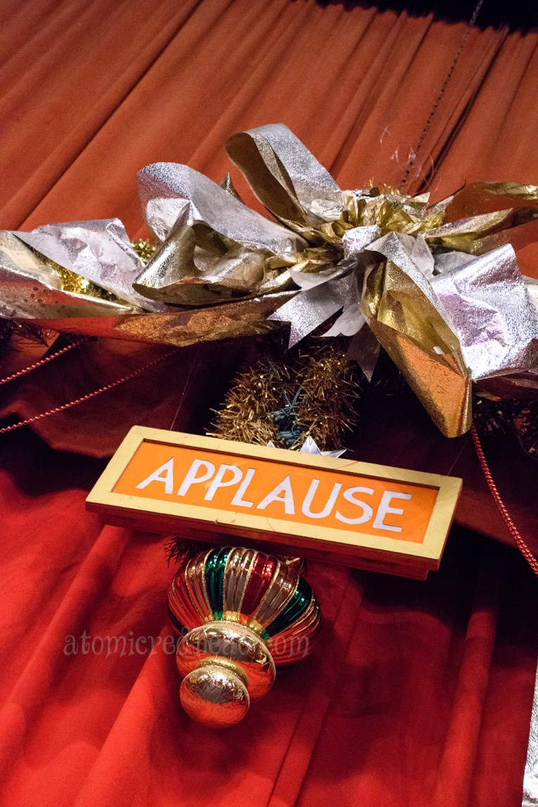 "Close up of a sign reading ""Applause"""