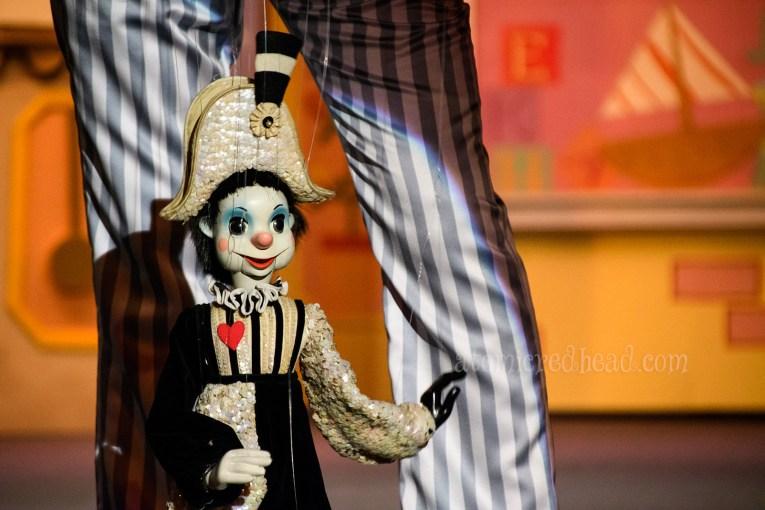 A harlequin marionette.