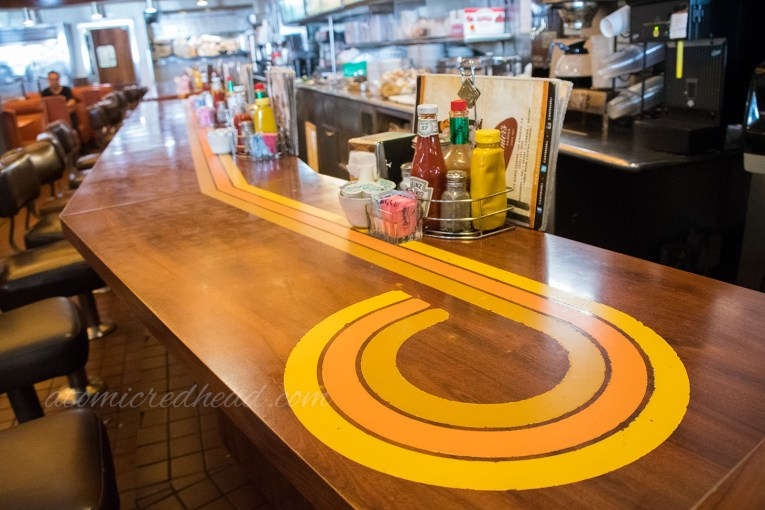 The counter at Canter's - a three tone yellow swirls adds to its retro vibe.