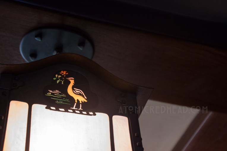 The Gamble family crest, a crane with a rose in its beak, is worked into an interior light fixture.