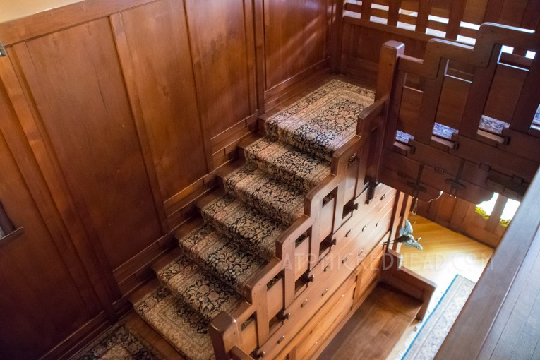 The central staircase, where the rail is also a stair step pattern.