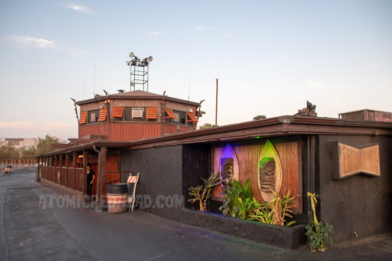 The concession stand with projection booth above. Done in a tiki hut style, with tiki masks and bamboo.