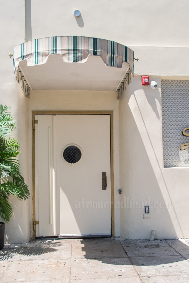 The door to what is now the Dahlia nightclub, which features a porthole style window.