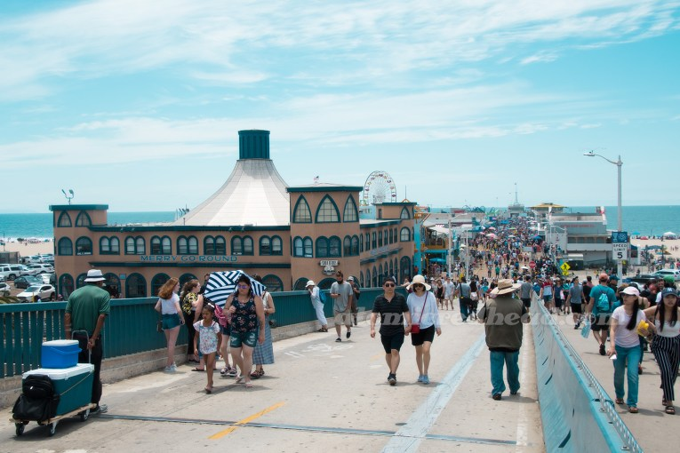 Looking down the pier, the Hippodrome, carousel, and buildings in the distance.