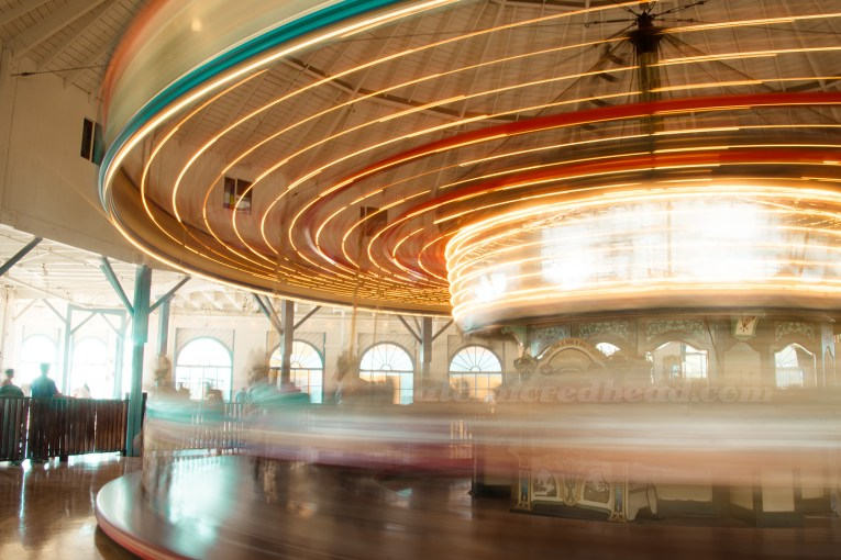 Long exposure of the carousel spinning - a blue of light and color.