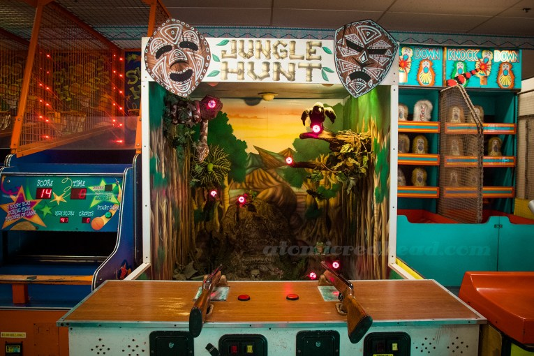 Inside Playland - Jungle Hunt, a jungle themed shooting gallery.