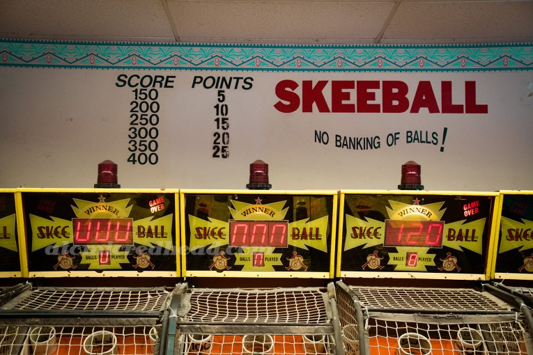 Inside Playland - the skee ball games.