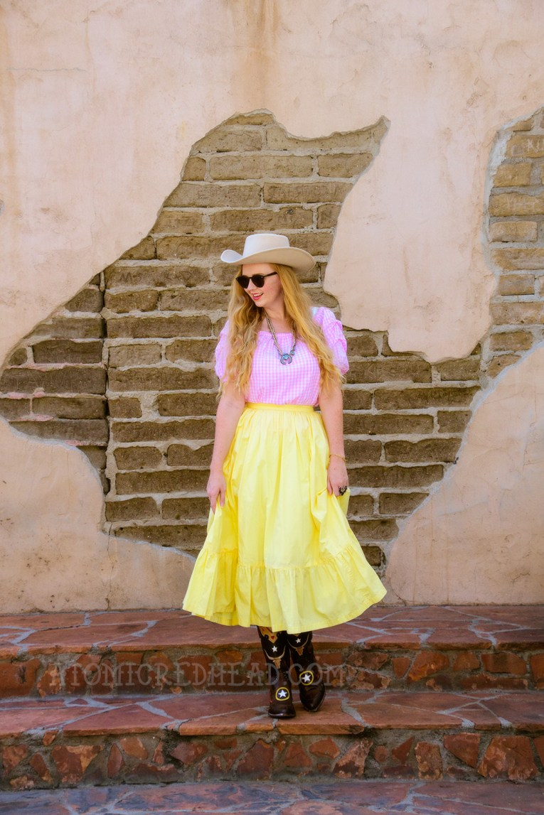 Inspired by the Sweetheart of the Rodeo, a cream cowboy hat, pink and white gingham peasant top, butter yellow skirt, and cowboy boots.