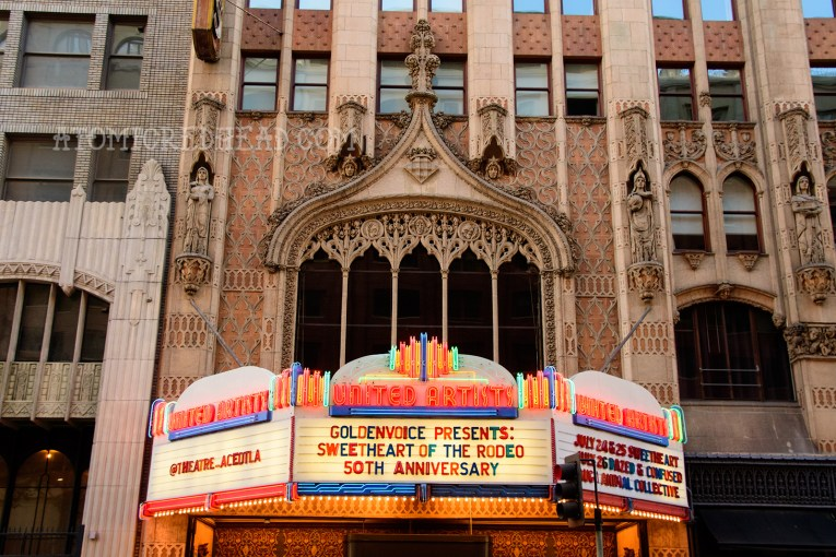 The front of the theater, a gothic church inspired look with colorful neon marquee.