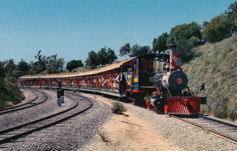 One of the Disneyland trains rounding a corner.