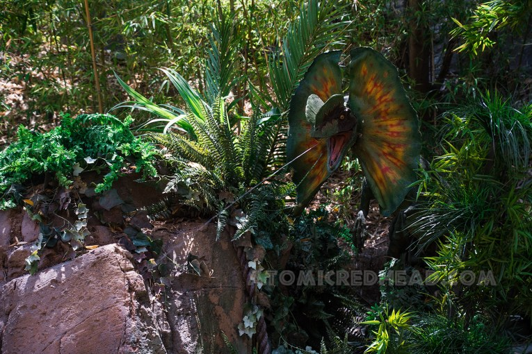 A Dilophosaurus squirts guests one last time.