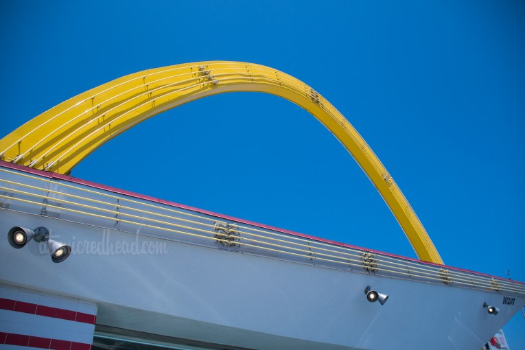 """Yellow """"Golden Arch"""" stretches over the slanted roof of the restaurant."""