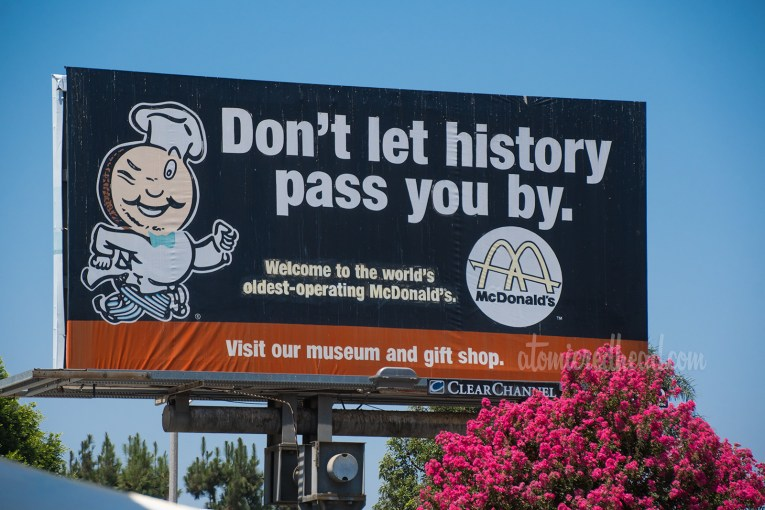 "Billboard for the McDonald's, featuring Speedee and the text ""Don't let history pass you buy."""