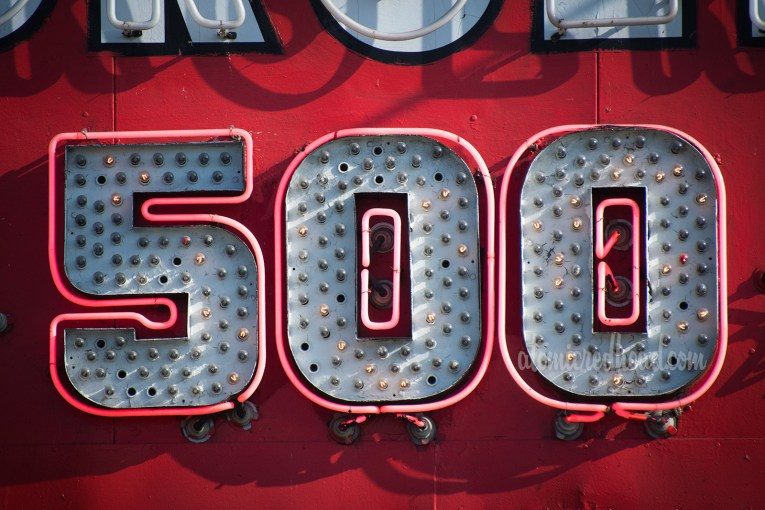 """Close-up of the neon """"500"""" portion of the """"we have sold over 500 million"""""""