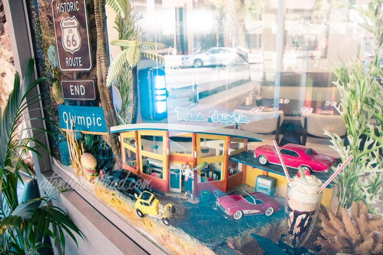 Inside fish tank are miniatures of Route 66 icons, including Mel's, and classic cars.
