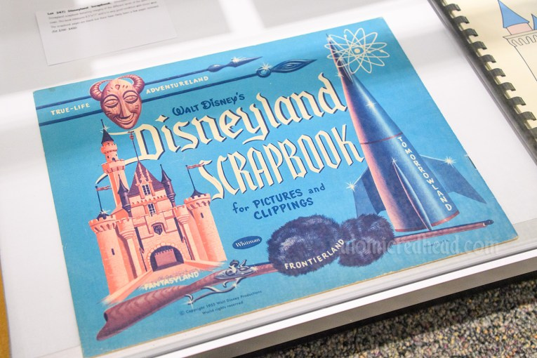 Vintage Disneyland scrapbook with illustrated images of the castle, rocket, Davy Crockett cap, and tiki mask.