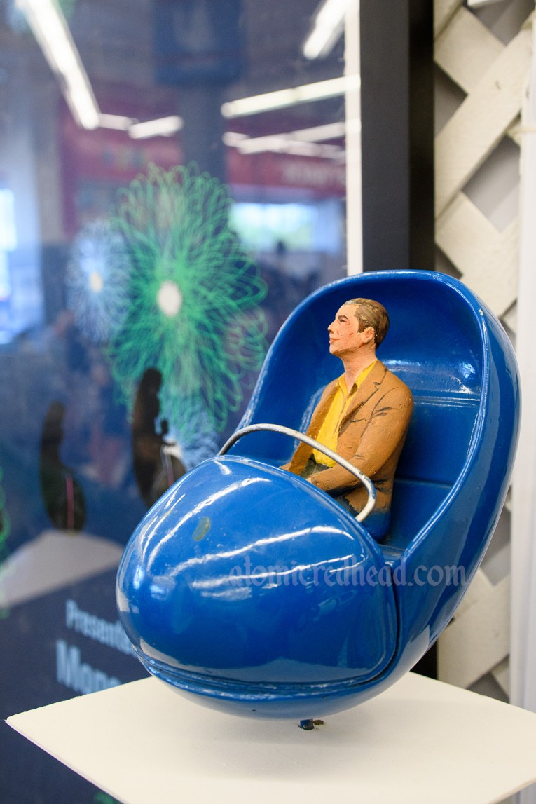 """Adventure Thru Inner Space Atomobile prop - a small ride vehicle with a figure sitting in it. Guests boarded one just like it, and were """"shrunk."""" In the queue Guests saw the vehicles """"shrink"""" with tiny versions, like this one, appear."""