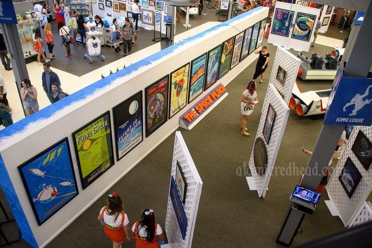 Overview of the exhibit, featuring various attraction posters, signage and more.